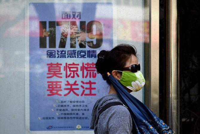 Cartazes espalhados na China, explicam sobre a H7N9. (Foto: Lancenet)